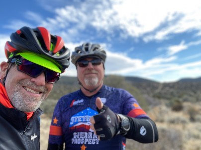 Smiles and a thumbs up from Chris. During our gravel ride near Sunrise Pass Road.