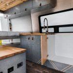 Custom van with hidden shower in kitchen.