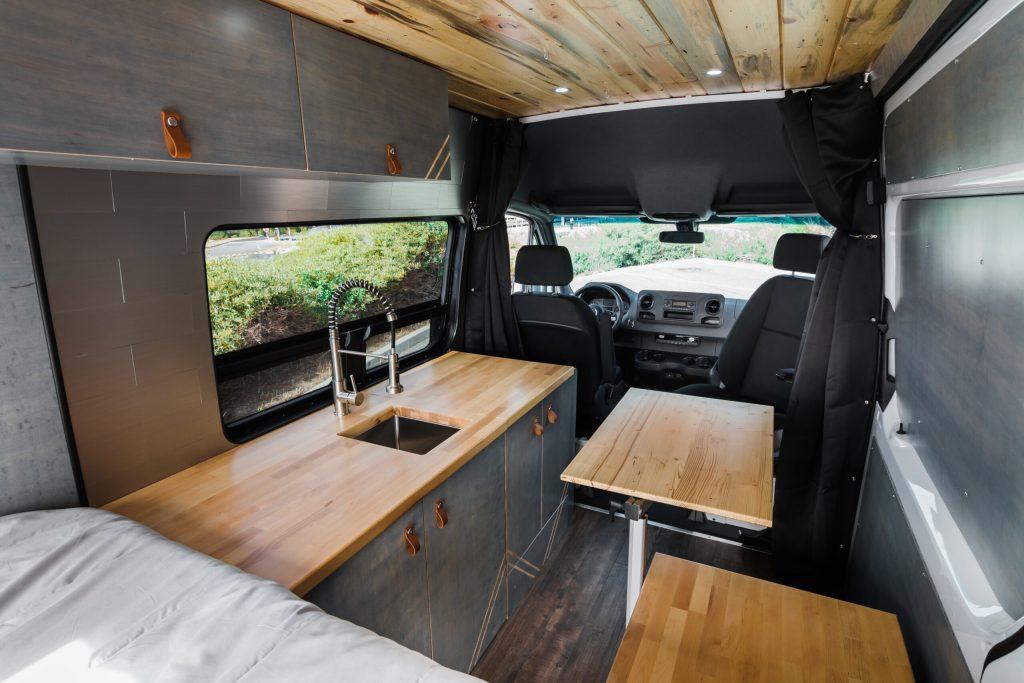 Camper van interior kitchen and Lagun table.