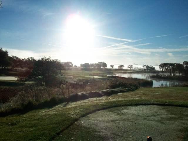 Sunrise over a river at Copper Valley Golf Course in Copperopolis, Calaveras County, California