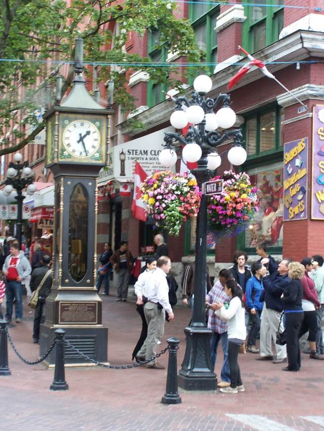 A crowd admires the steam clock in Gastown, Vancouver, BC