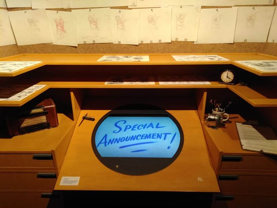 A recreated vintage drawing desk with multiple sketches at the Walt Disney Family Museum in San Francisco
