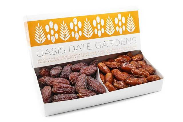 An open box packed with two types of dates from Oasis Date Gardens, a gourmet gift idea for 2020