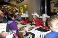 Signing autographs at the CSHA booth at 2013 Cow Palace