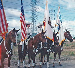 Parade Riders carrying Flags