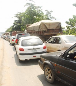 A long line of cars at the Odukpani Junction