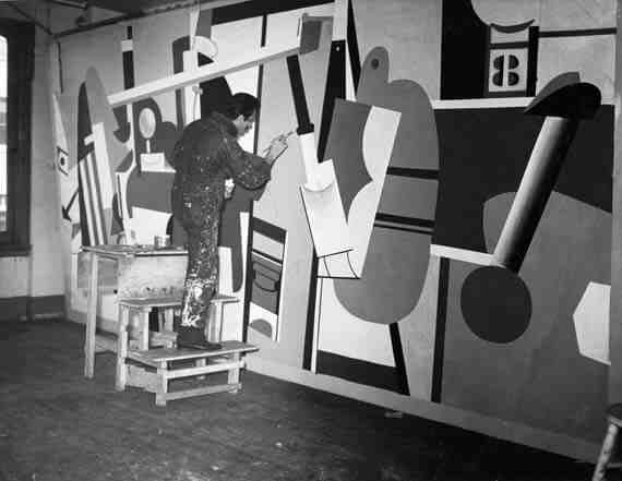 Arshile Gorky at work on Activities on the Field, his mural for the Newark Airport Administration Building