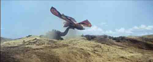 Mothra gets the upper hand by exploiting Godzilla's tail