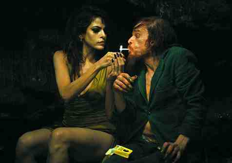 Eva Mendes and Denis Lavant in Holy Motors