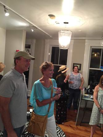 A great crowd gathered at the office reception for September's First Friday Art Walk featuring artist Karen Romagna.