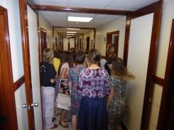 sisters-backs-hallway