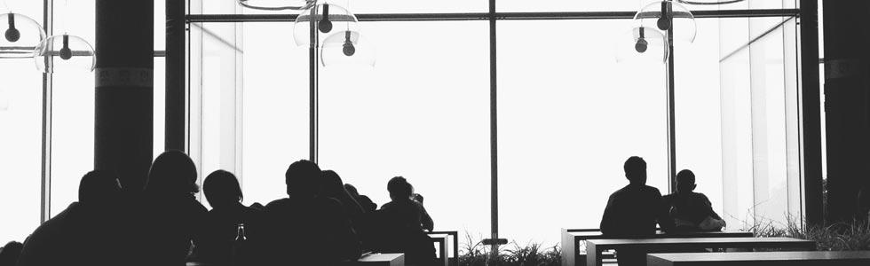 People working in an open floor plan office