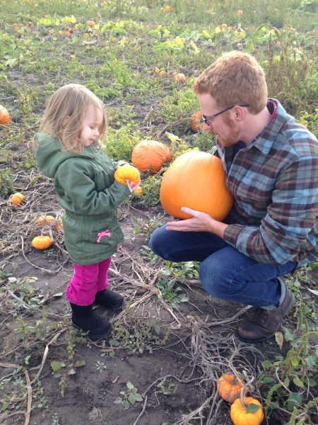 two of my loves, comparing pumpkins
