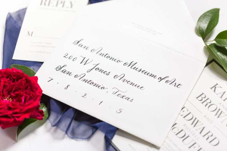 Formal Copperplate Calligraphy Envelopes - Left Alligned by CalliRosa Calligrapher in San Antonio Texas - white envelope with black lettering