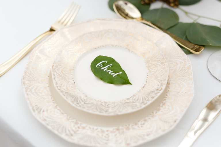Greenery Leaf Placecard with White Calligraphy at Villa at Cielo Vista by CalliRosa Calligrapher in San Antonio Texas