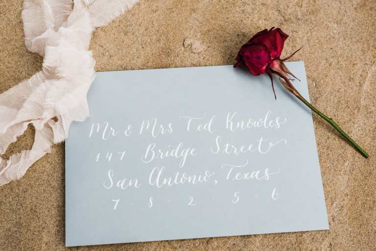 Modern Calligraphy Envelopes - Centered by CalliRosa Calligrapher in San Antonio Texas - grey envelope with white lettering