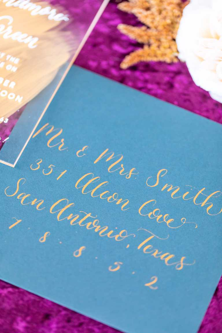 Modern Calligraphy Envelopes - Centered by CalliRosa Calligrapher in San Antonio Texas - teal envelope with gold lettering