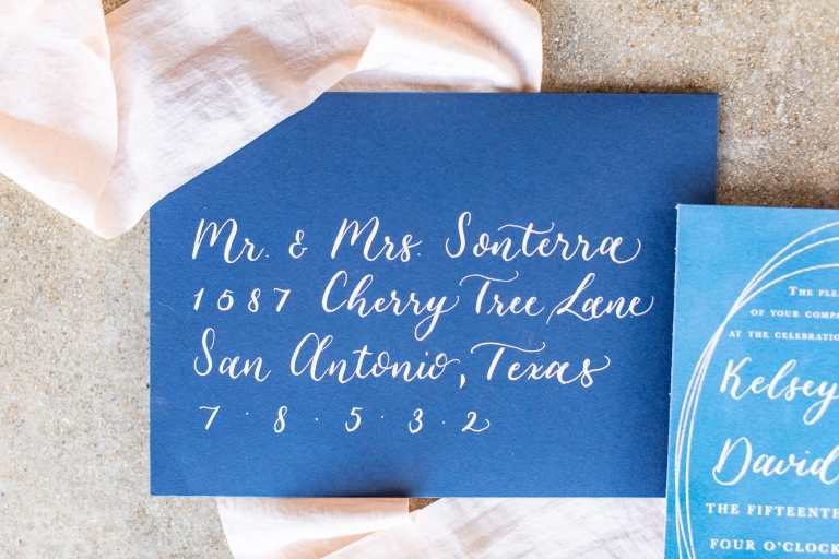 Modern Calligraphy Envelopes - Left Alligned by CalliRosa Calligrapher in San Antonio Texas - navy envelope with white lettering