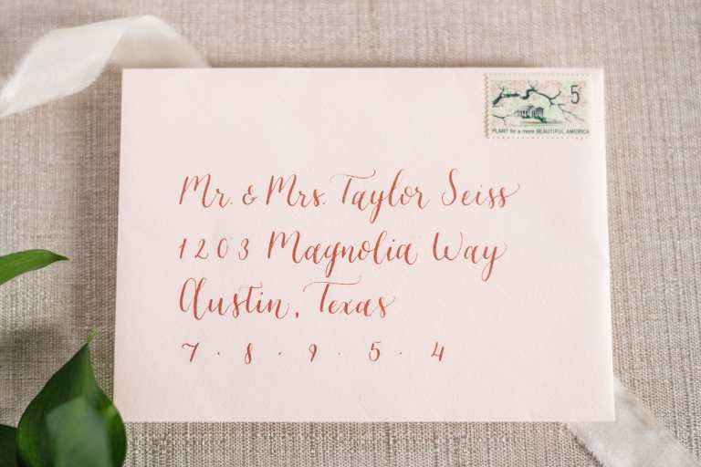 Modern Calligraphy Envelopes - Left Alligned by CalliRosa Calligrapher in San Antonio Texas, on blush envelopes with rose gold lettering