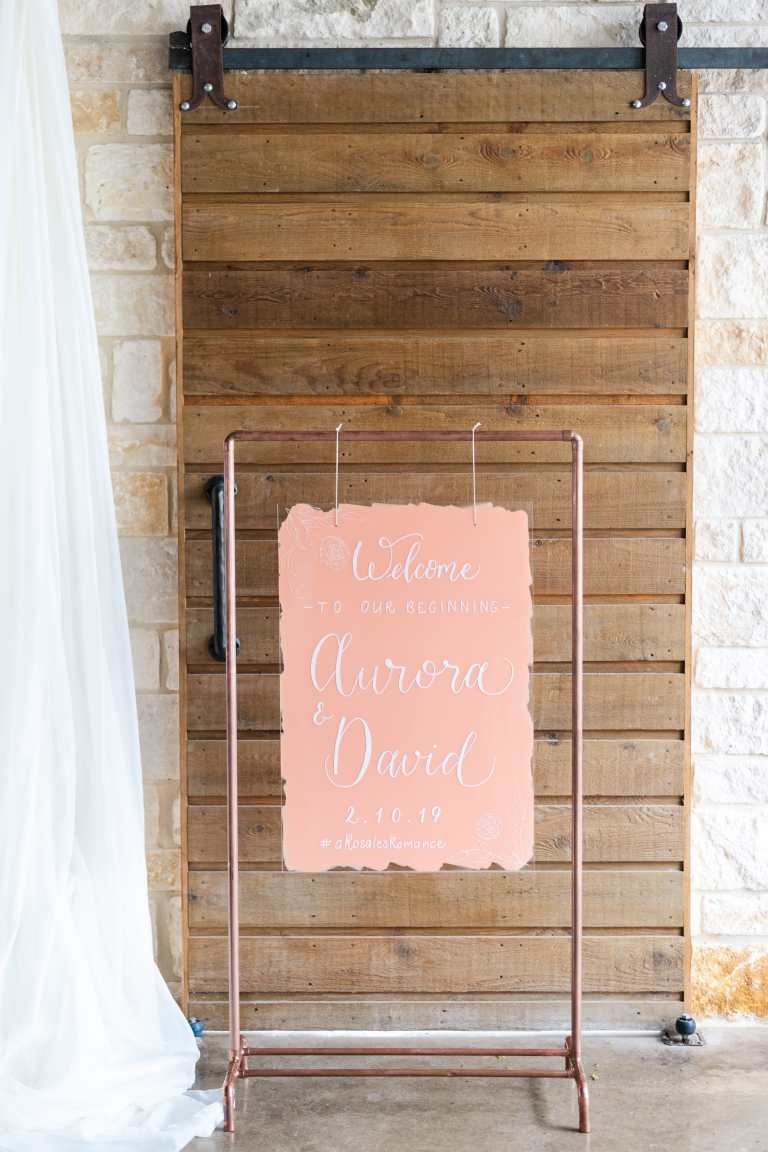 Peach Acrylic Wedding Welcome Sign with White Calligraphy on Copper Stand at Rockin B Ranch by CalliRosa Calligrapher in San Antonio Texas
