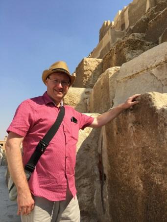 Standing at the pyramid base