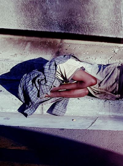 Homeless person asleep on the street in Cape Town