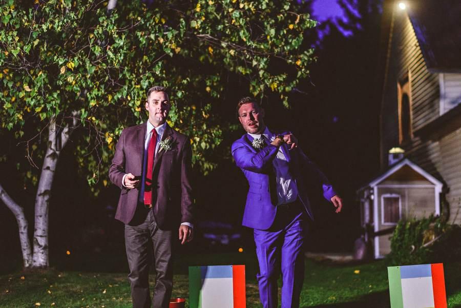 groom and groomsmen playing yard game