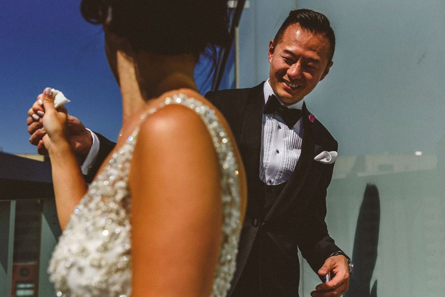 Groom checking out bride at Thompson Hotel Wedding