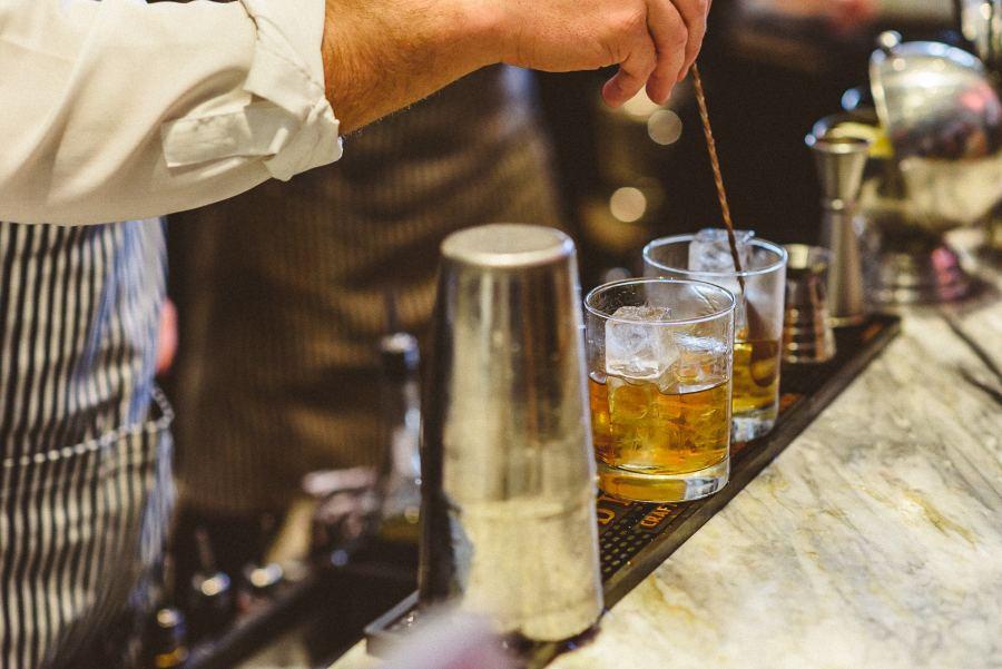 Bartender mixing drinks at Colette Restaurant