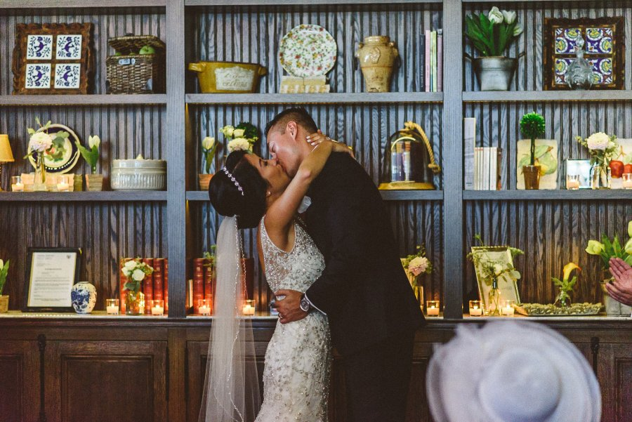 First kiss at wedding ceremony Colette Restaurant