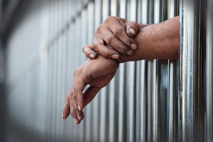 hands outside jail cell