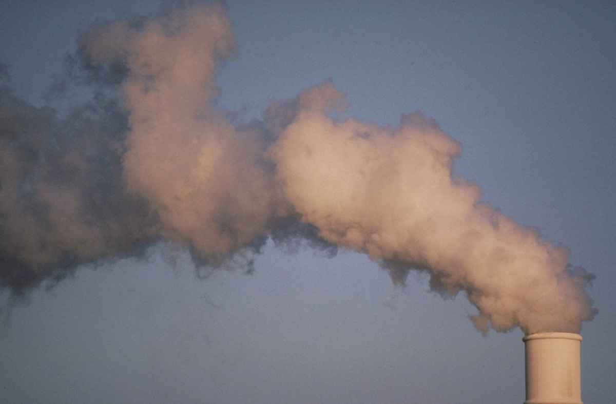 Air pollution smoke rising from plant tower. From Wikimedia Commons.