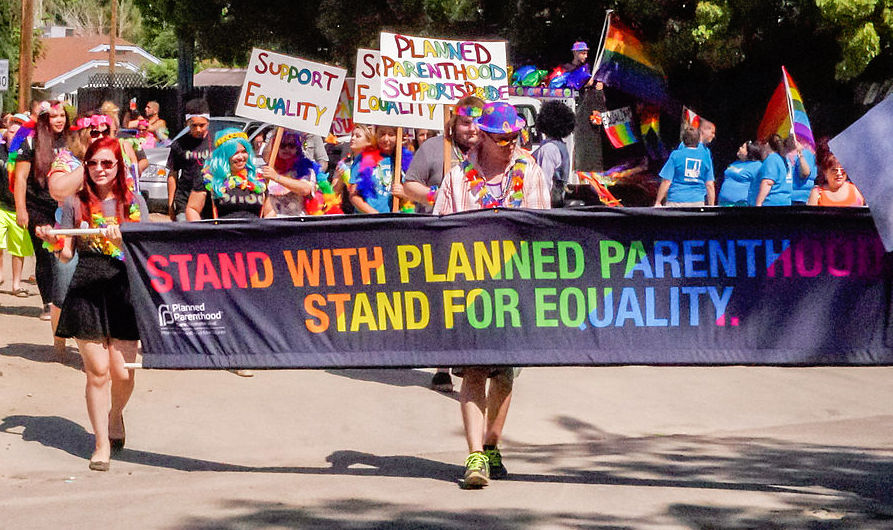 Supporters of Planned Parenthood marching in Fresno parade. Photo by David Pradas.