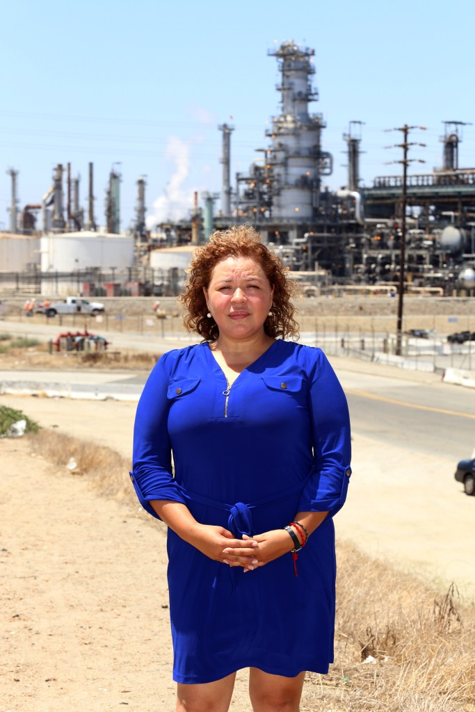 Magali Sanchez-Hall in front of the Tesoro refinery near her home.