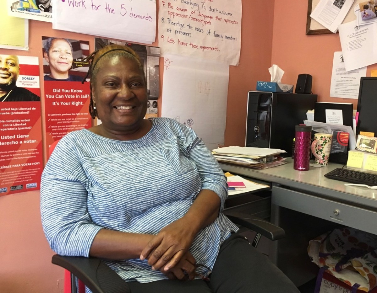 """Sandra Johnson, at her office in San Francisco, urges that people not be """"held hostage by our mistakes."""" Photo by Lee Romney for CALmatters"""