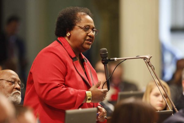 Shirley Weber speaks into a microphone on Assembly floor.