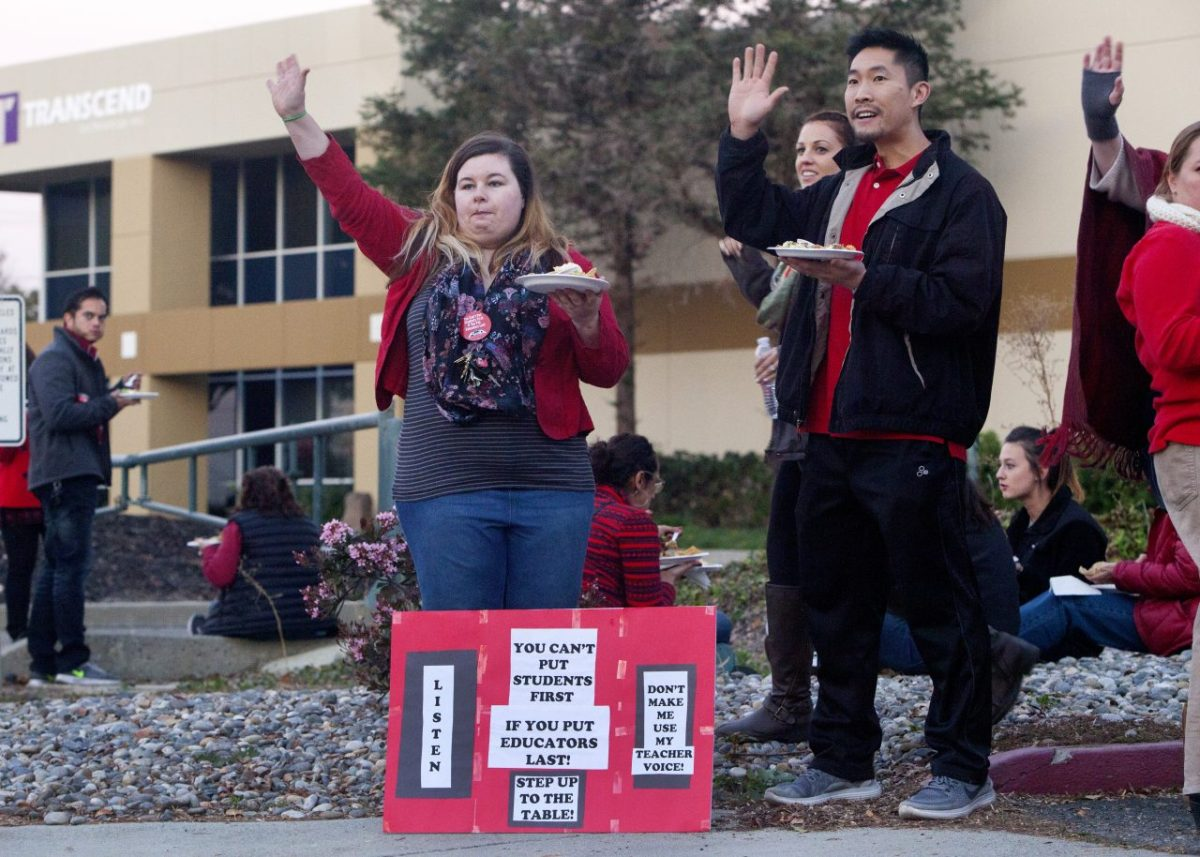 Tiffany Stelle and Donald Hui, teachers at Mission San Jose High School in Fremont, joined a tailgating action over stalled contract talks. An agreement has since been reached. Photography by Penni Gladstone for CALmatters