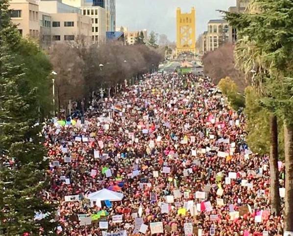 Tens of thousands demonstrate for women's equality at the 2017 Women's March in Sacramento. Photo via Creative Commons.