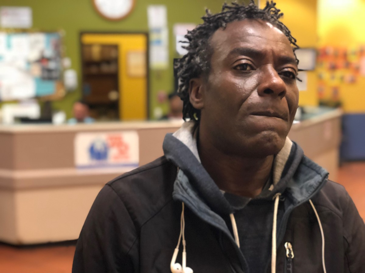 Sean Kayode, outside the Next Door homeless shelter in San Francisco, is suing the city—saying he lost his means of food-delivery employment and his home when his car was impounded in March for having too many parking tickets. Photo by David Gorn for CALmatters