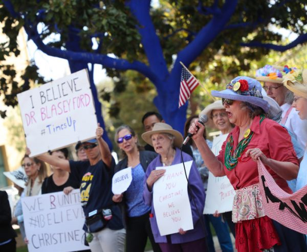 Community members gather for a rally in support of Christine Blasey Ford in front of City Hall on Thursday, Sept. 27, 2018, in Palo Alto, Calif. Ford, testified during a Senate Judiciary Committee hearing about her allegations that Supreme Court nominee Judge Brett Kavanaugh attempted to rape her in the early 1980s. Photo by Aric Crabb/Bay Area News Group