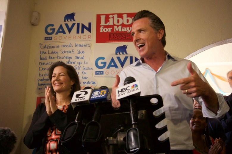 Gavin Newsom campaigns for governor alongside Oakland Mayor Libby Schaaf. Photo by Ben Christopher for CALmatters