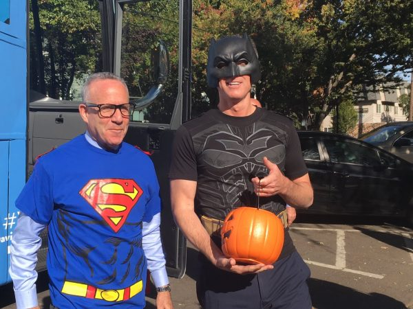 Sacramento Mayor Darrell Steinberg, left, and Lt. Gov. Gavin Newsom, right, hand out candy to kids at a preschool in Sacramento on Halloween.