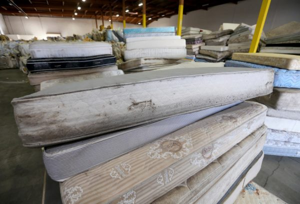 Old mattresses are seen before they're crushed by a baler at the Blue Marble Materials recycling center in San Leandro, Calif., on Wednesday, Jan. 25, 2017. The Bye Bye Mattress program kicked off in Jan. 2016 to help rid landfills, streets and waterways of discarded mattresses. (Jane Tyska/Bay Area News Group)