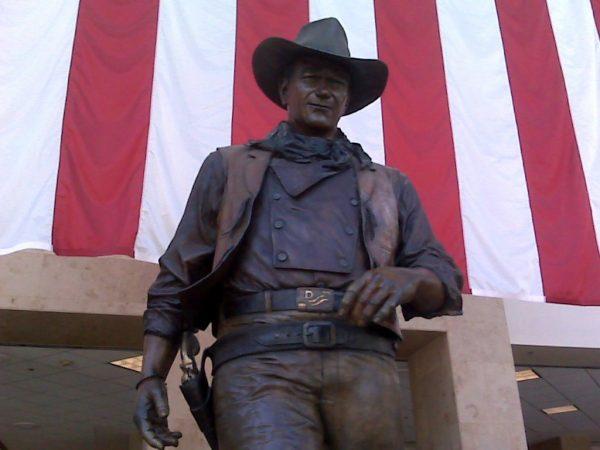 John Wayne's statue at John Wayne / Orange County Airport (SNA). Photo courtesy of Creative Commons.
