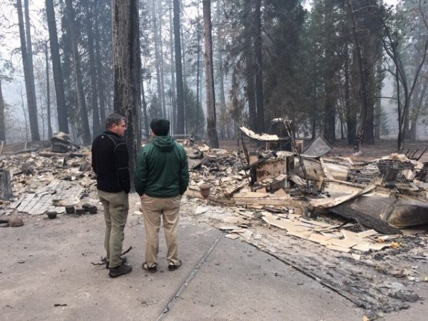 Photo of Assemblyman Jim Wood surveying fire damage in Paradise, CA.