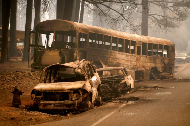 Cars and a bus sit abandoned on the main artery in Paradise, November 9, 2018, the day after many fleeing residents were trapped by the overwhelming flames of the Camp Fire. (Karl Mondon/Bay Area News Group)