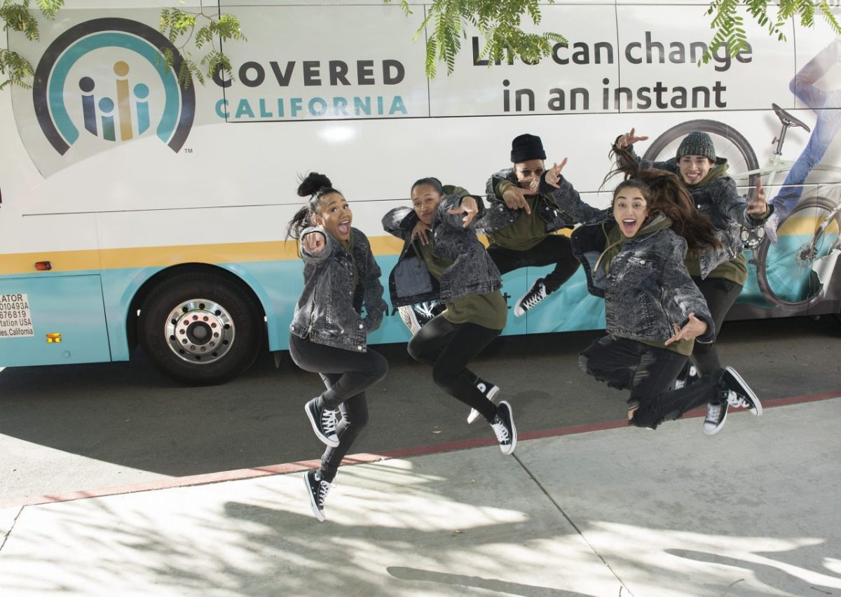 The Skullie Nation dancers joined a rally for Covered California in Riverside in November, part of a statewide bus tour to publicize sign-ups for the exchange. An aggressive state campaign has lessened the impact many other states are feeling from federal antipathy toward the Affordable Care Act. Photo via Covered California
