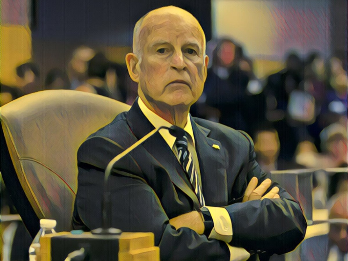Jerry Brown folding his arms.