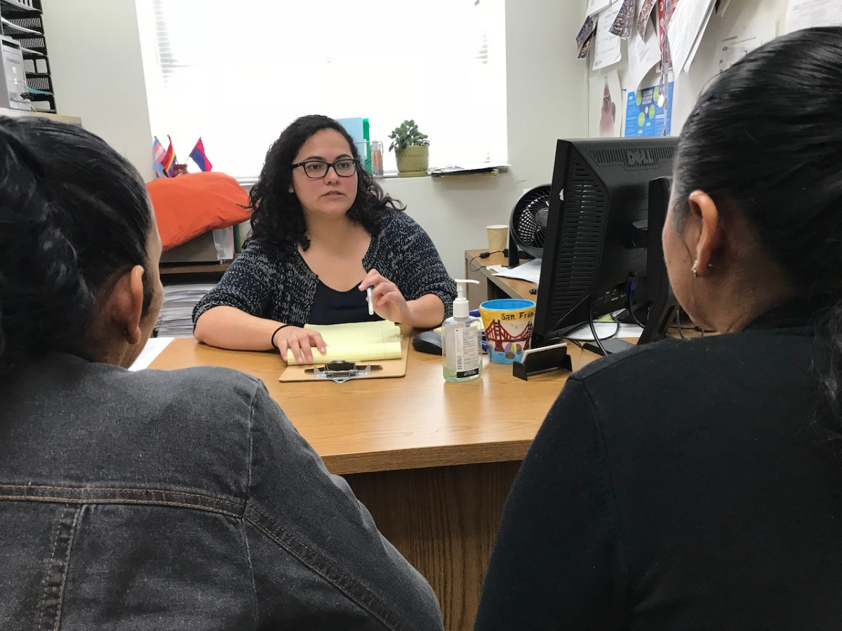 Patricia Ortiz meets with Rosa at the Esperanza Immigrant Rights Project offices in Los Angeles to discuss her asylum case. Photo by David Wagner, KPCC