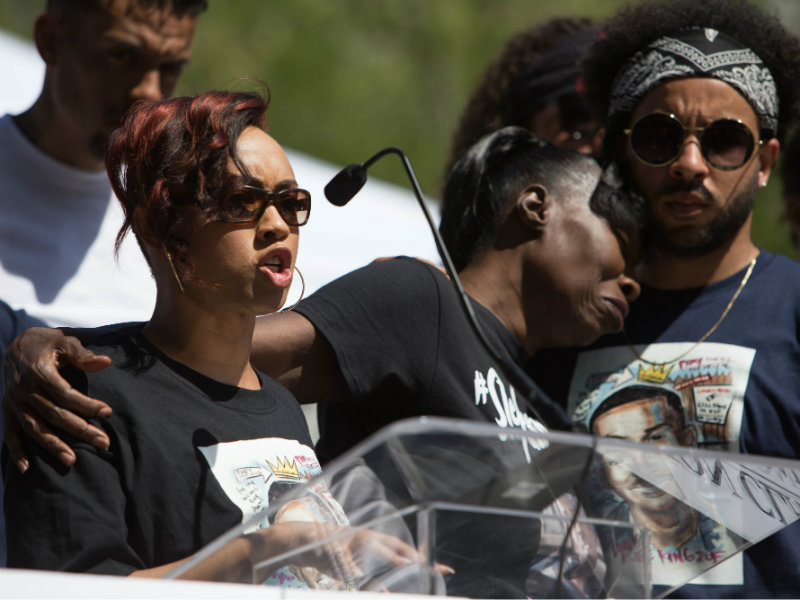 Photo of Jamilia Land and family of Stephon Clark at a rally on March 31, 2018, days after Sacramento police killed Clark. Photo credit: Andrew Nixon / Capital Public Radio